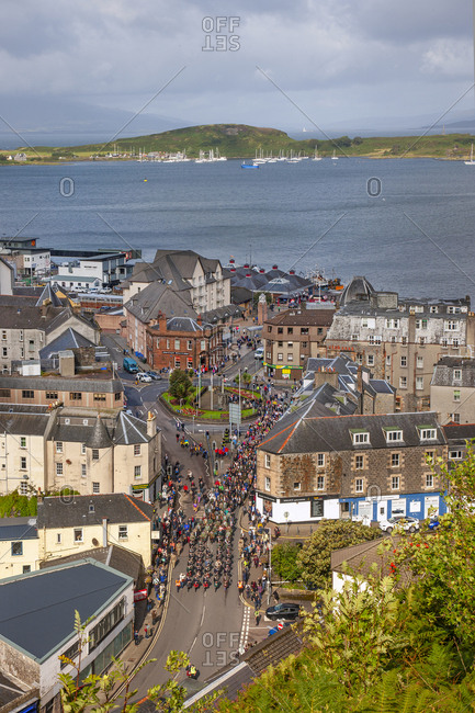 Argyll, Scotland - August 22, 2019: Bird's eye view of the Oban Highland Games Precession in downtown Argyll