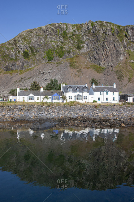White buildings on the coast of Ellenabeich and Easdale island, Argyll, Scotland