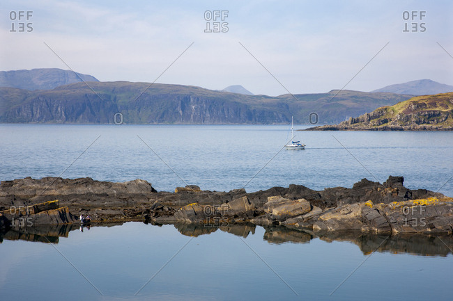 A distant Mull and Inch Island from the Slate Quarry on Easdale Island, Argyll, Scotland