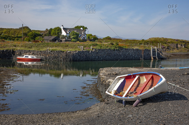 Argyll, Scotland - August 25, 2019: Boat on the coast of Easdale Island, Argyll