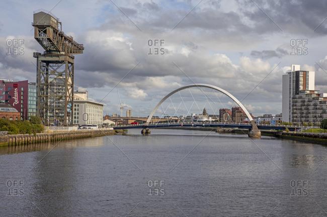 Glasgow, Scotland - September 23, 2019: Finnieston Crane and distant Clyde Arc, Glasgow