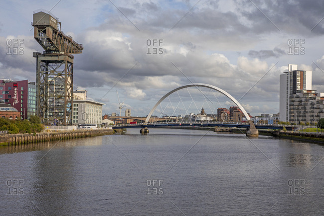 Glasgow, Scotland - September 23, 2019: Finnieston Crane and distant Clyde Arc, Glasgow