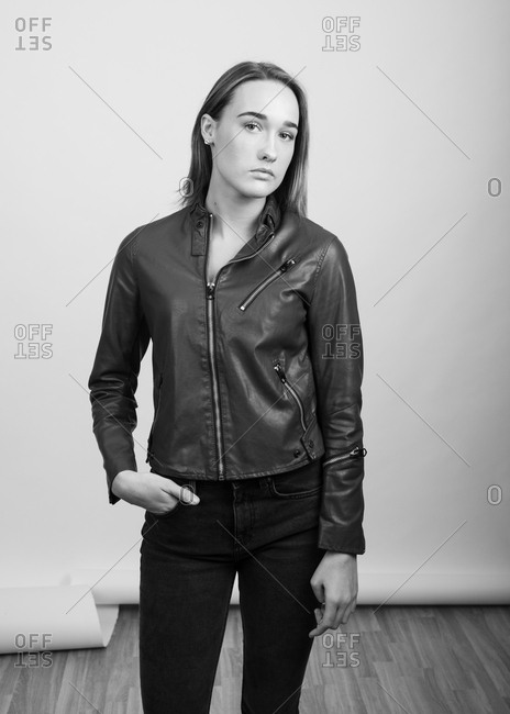 Black and white portrait of a young woman wearing a leather jacket