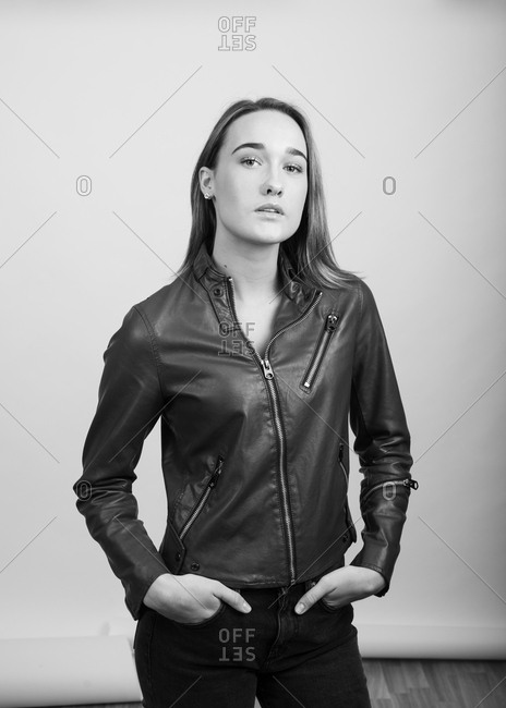 Grayscale portrait of a young woman wearing a leather jacket