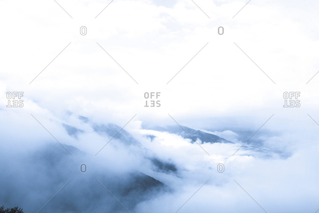 Scenic view of clouds covering rock formations