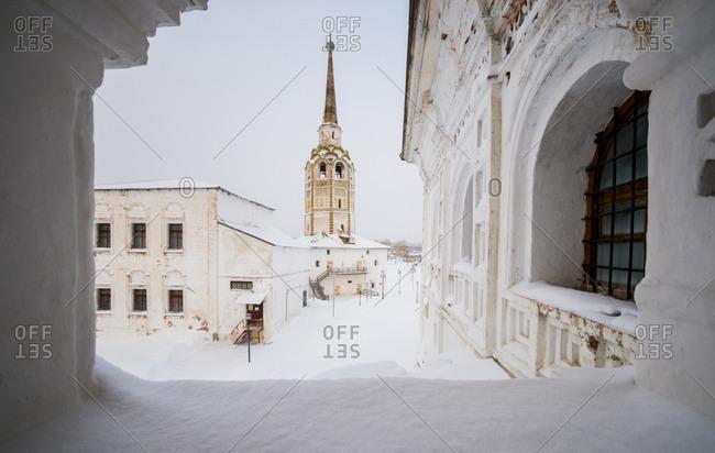 Church against sky seen through window during winter
