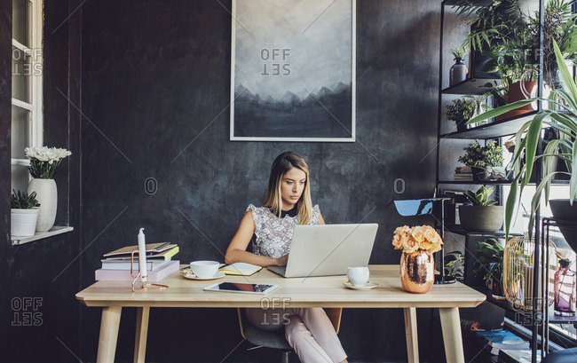 Businesswoman working on laptop computer at home office