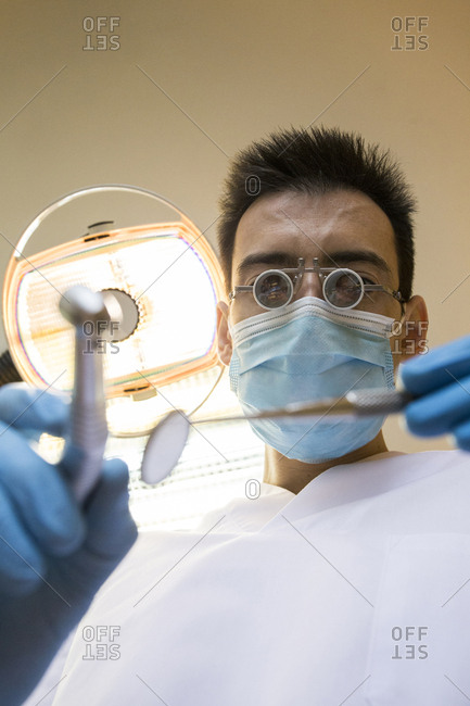Low angle view of dentist working in clinic