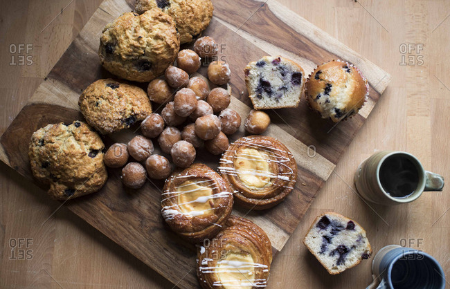 High angle view of sweet food with coffee on wooden table