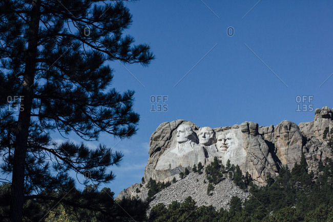 View of Mt Rushmore national monument against blue sky
