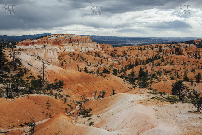 High angle view of rock formations against cloudy sky
