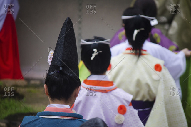 Rear view of women in traditional Japanese clothing