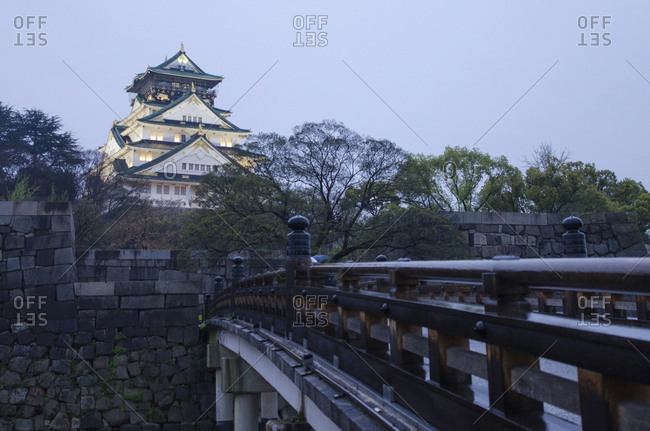 Osaka castle against sky at dusk