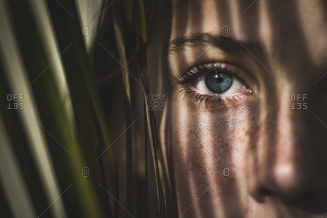 Close-up of girl's eye with leaves