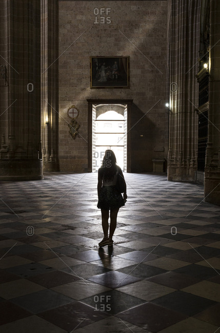 Spain, Segovia - September 4, 2016: Rear view of woman standing in cathedral