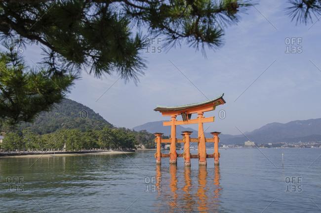 Japan, Hatsukaichi - December 20, 2016: Torii gate at Itsukushima Shrine against sky