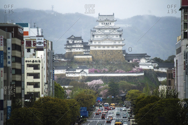 Japan, Himeji - December 20, 2016: City street leading towards Himeji-jo Castle