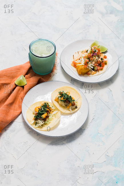 Overhead view of tacos and a margarita