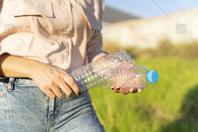 Woman's hands holding empty plastic bottles- close-up