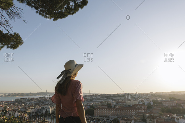 Rear view of woman in front of the city panorama- Lisbon- Portugal
