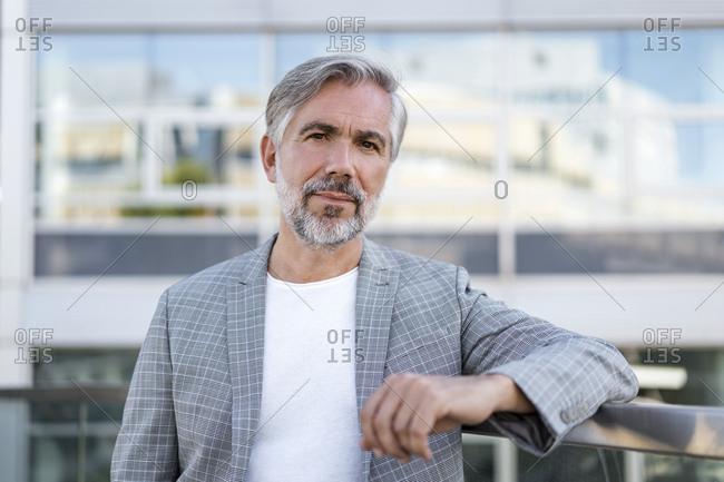 Portrait of fashionable mature businessman outdoors