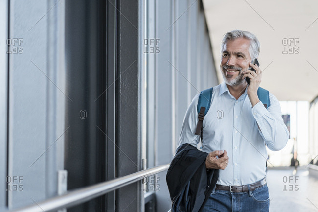 Smiling mature businessman on the phone