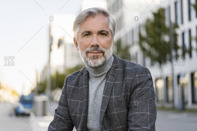Portrait of fashionable mature businessman in the city