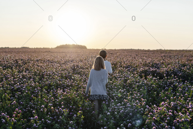 Two kids on a clover field