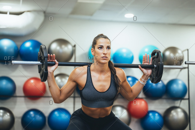 Woman exercising with weight in a gym