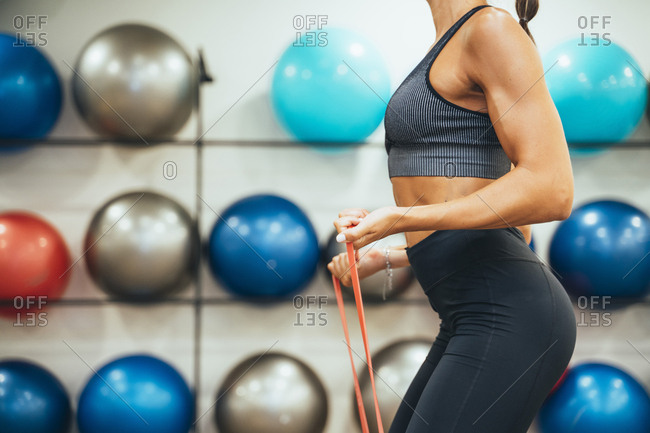 Woman exercising with fitness band in a gym