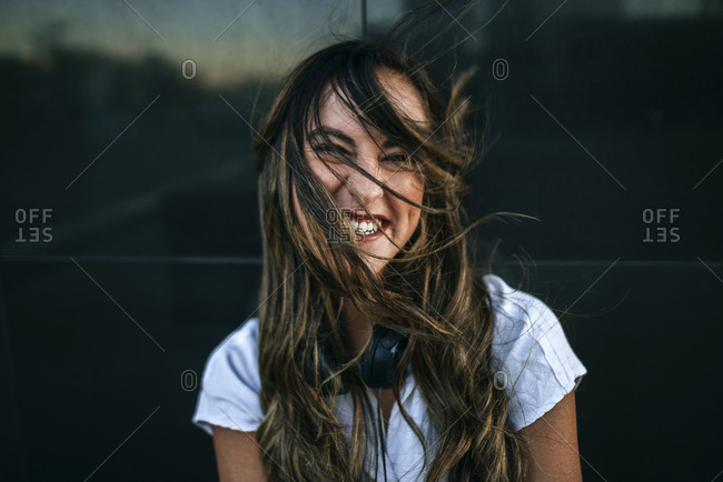 Laughing woman with hairs on her face- black background