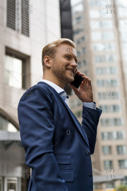 Young businessman with smartphone in Bangkok