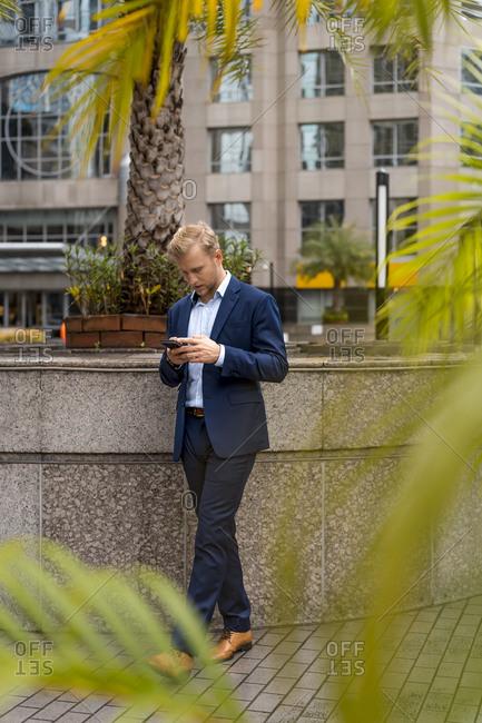 Young businessman using smartphone in Bangkok