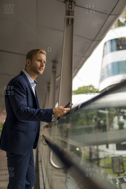 Young businessman with businessman on pedestrian bridge