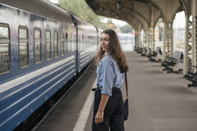Young female traveler on train station