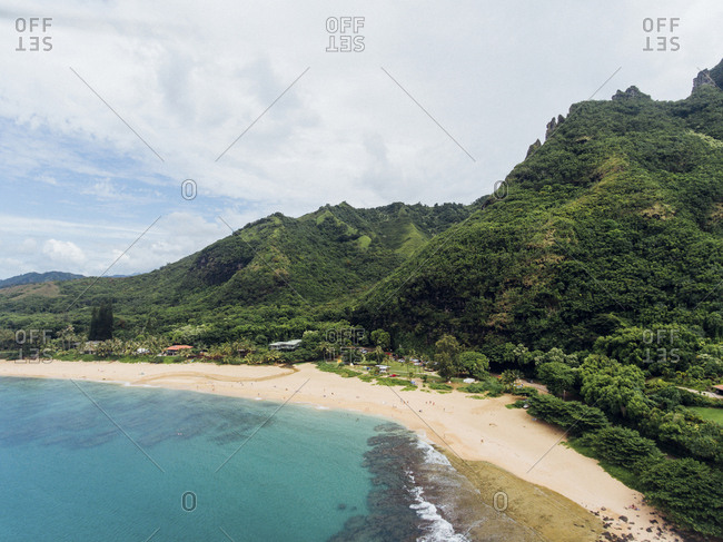 High angle scenic view of mountains by sea against cloudy sky