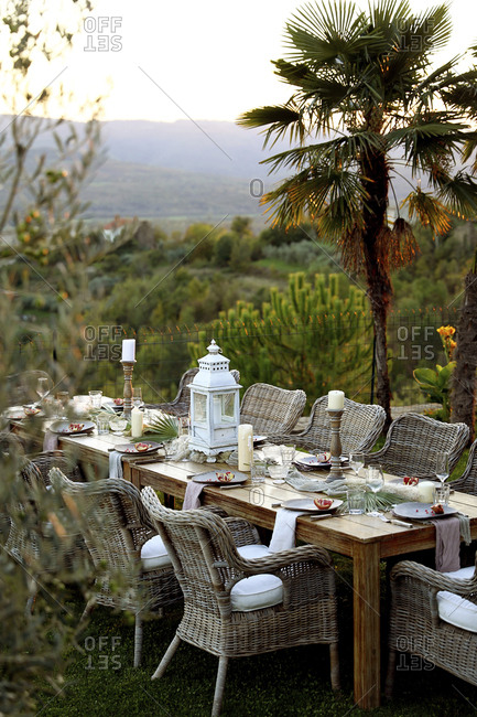 High angle view of decorated chairs and table outdoors