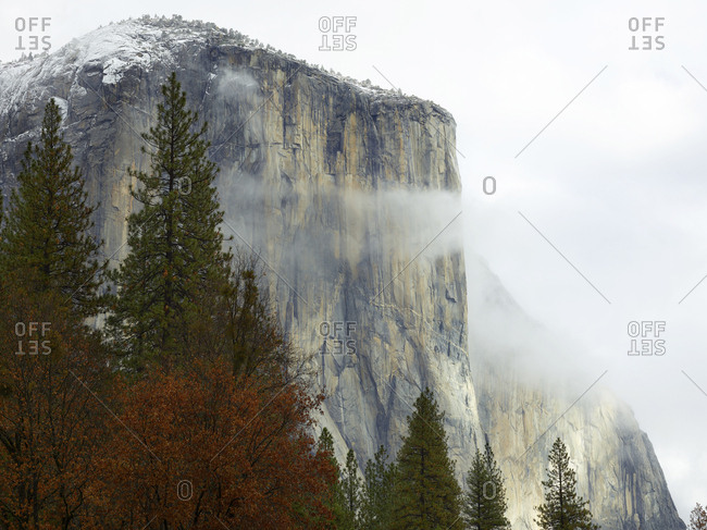 Low angle view of rocky mountains against sky at Yosemite National Park