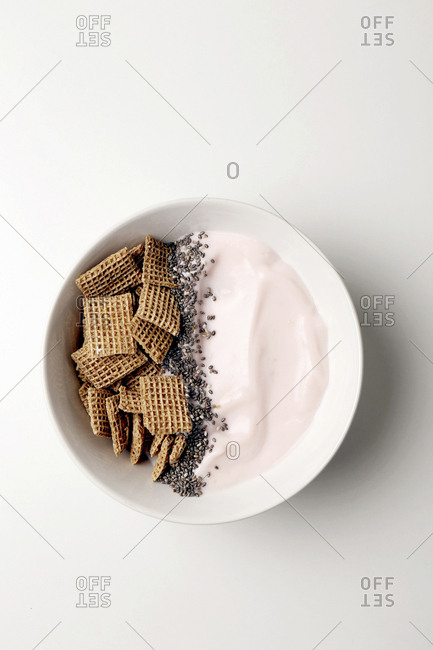 Overhead view of breakfast served in bowl over white background