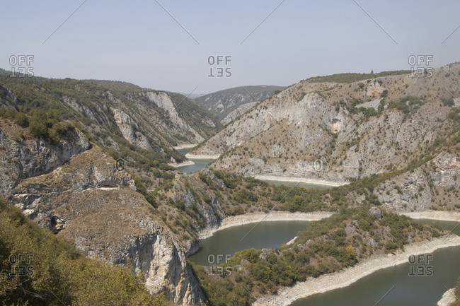 High angle scenic view of river amidst mountains against sky