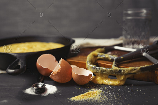Close-up of messy kitchen counter with broken eggshells