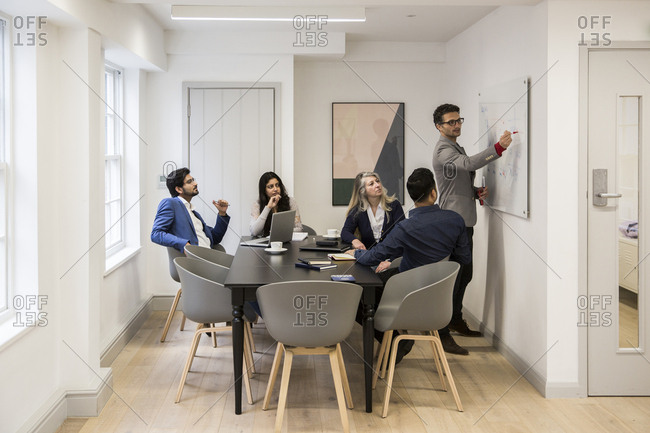 Business people discussing during meeting at desk in office