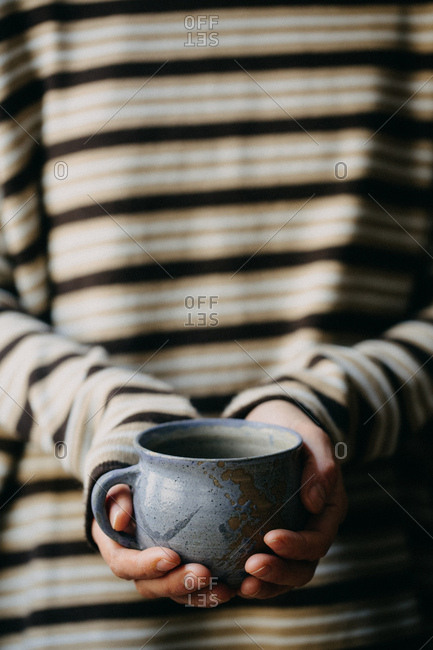 Woman With A Cup Of Coffee In Her Hands.