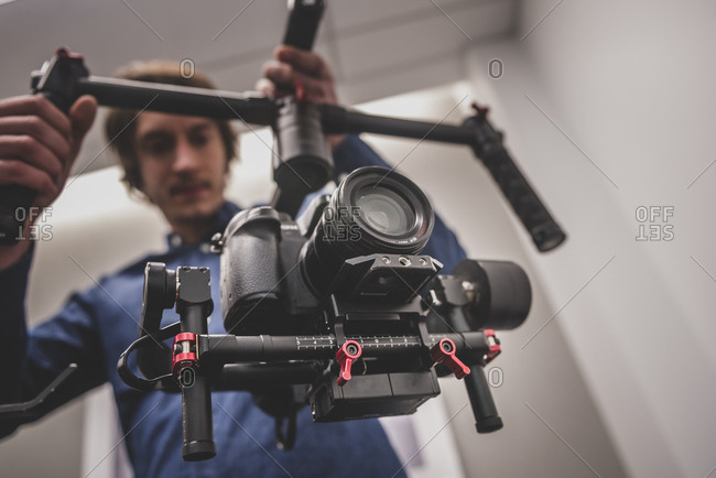 Videographer filming with gimbal and dslr