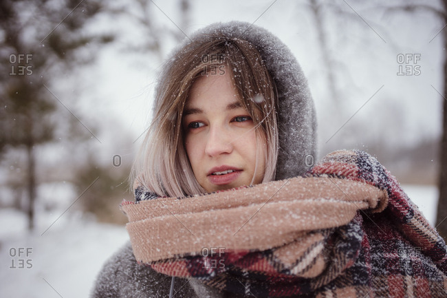 portrait of a woman in a scarf and hood in winter
