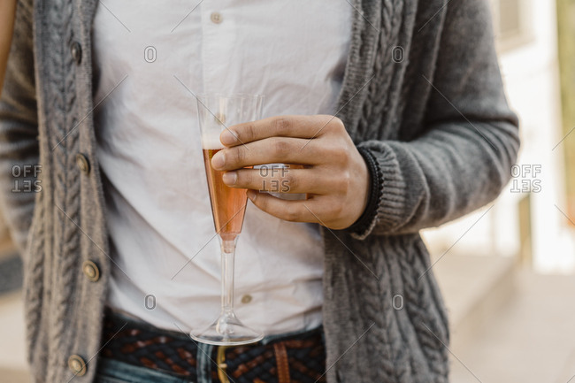 Close up of male hand holding a glass of champagne