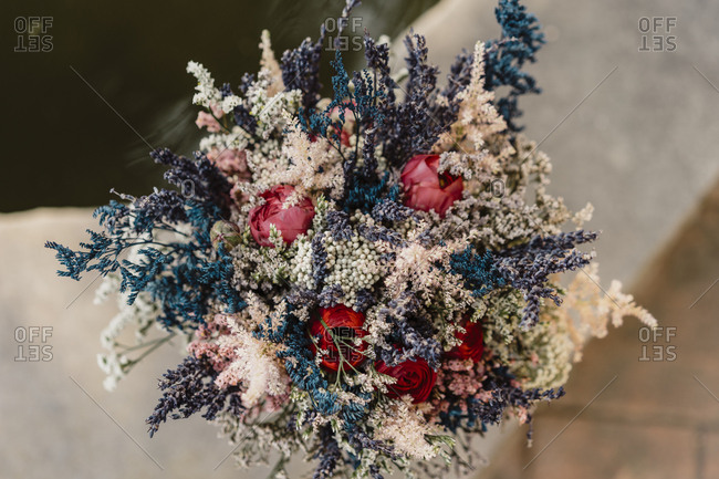 Bohemian bouquet of roses and flowers during daylight outdoors