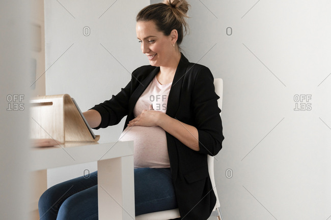 young pregnancy woman working at office