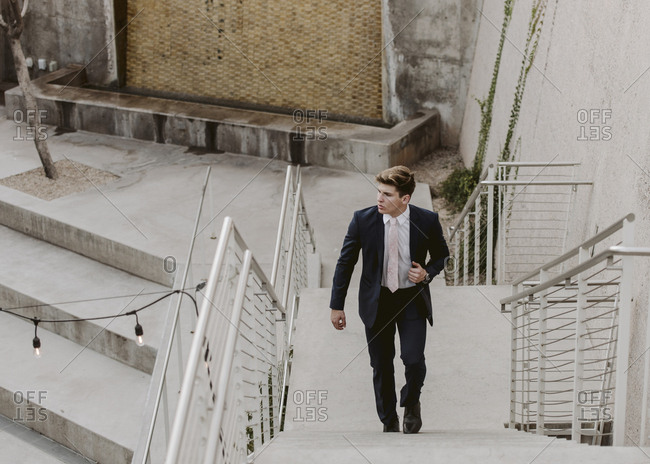 Handsome man walking up the stairs