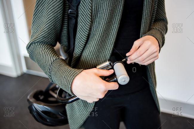 Close up of woman unlocking bike lock